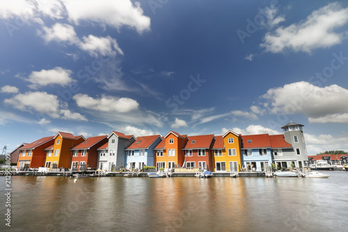 Foto Murales colorful buildings on water on sunny day