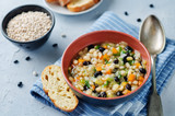 Barley white and balck beans vegetable soup - 212960617