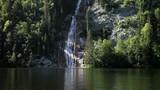 Small waterfall on Toplitzsee (Toplitz lake) mountain lake, in Salzkammergut, Styria, Austria. - 212960647
