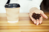 Good Morning. Coffee Time. Coffee to go and beans on a wooden background - 212963019