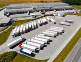 Aerial view of warehouse with trucks. Industrial background. Logistics from above.  - 212968647
