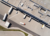 Aerial view of warehouse with trucks. Industrial background. Logistics from above.  - 212968669