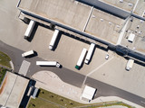 Aerial view of warehouse with trucks. Industrial background. Logistics from above.  - 212968695