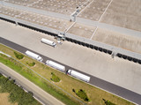 Aerial view of warehouse with trucks. Industrial background. Logistics from above.  - 212968833