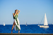 Fashion woman against yachts on sea