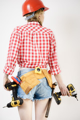 Girl using some power tools for work at home
