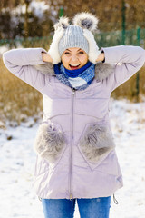Female wearing warm outfit during winter