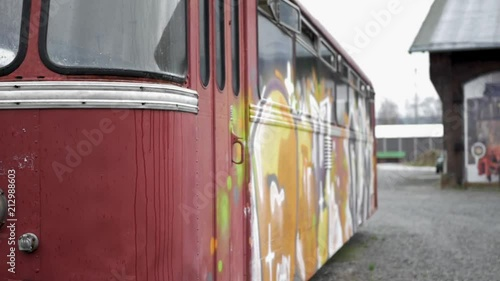 An old train painted with graffiti.