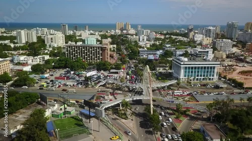 Aerial crane up footage of pedestrian overpass in Santo Domingo