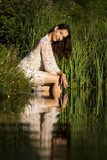 Portrait of a beautiful woman wearing a wet dress - 213004896
