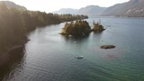 Drone shot on a Cowichan lake overlooking boats and mountains. - 213008072