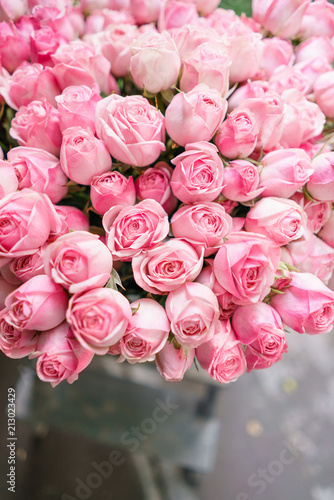 light pink bush roses flowers in vase on wooden table. Beautiful summer bouquet. Arrangement with mix flowers. The concept of a flower shop. Content for the catalog - 213023429