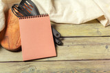 Blank sheet of opened notepad and kitchen utensils on  table with tablecloth, copy space - 213030806