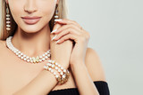 Fashioable jewelry on female body. Necklace, Bracelet and Earrings