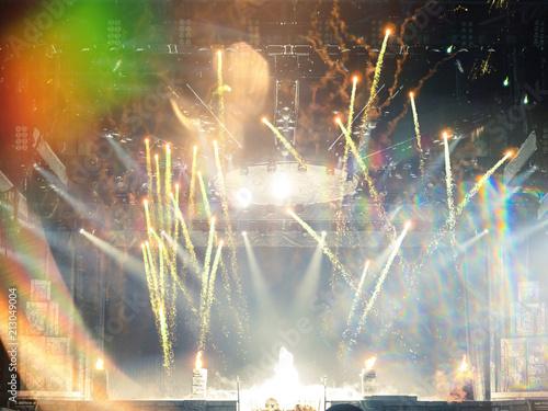 Live music crowd under a firework show - 213049004