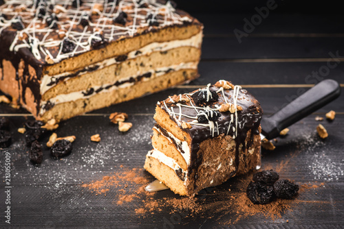 Sweet cake with layers on black background