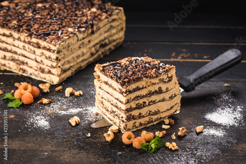 Sweet cake with layers on black background - 213055081