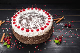 Sweet white cake with cream and cherry on the black background - 213055286