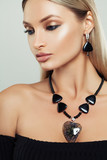 Closeup Fashion Beauty Portrait of Glamorous Woman with Makeup, Jewelry Necklace and Earrings - 213056257