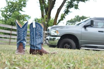 cowboy boots and a big truck