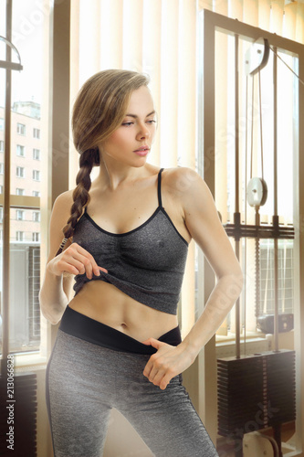 Fotobehang Fitness Gorgeous young sports girl in a gym