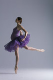 Young beautiful pregnant ballerina is posing in studio - 213071243