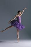 Young beautiful pregnant ballerina is posing in studio - 213071266