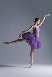 Young beautiful pregnant ballerina is posing in studio - 213071283