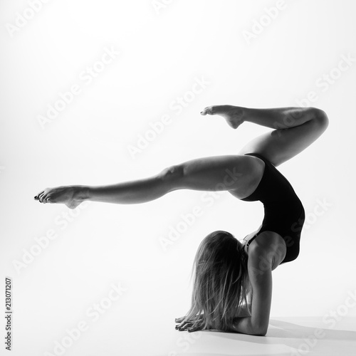 Young beautiful athlete is posing in studio