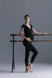 Young beautiful pregnant ballerina is posing in studio - 213071439
