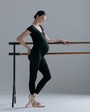 Young beautiful pregnant ballerina is posing in studio - 213071609