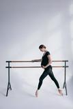 Young beautiful pregnant ballerina is posing in studio - 213072008