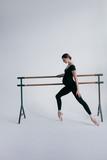 Young beautiful pregnant ballerina is posing in studio - 213072028
