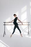 Young beautiful pregnant ballerina is posing in studio - 213072051