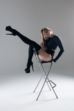 Young beautiful dancer is posing in studio - 213072284