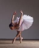 Young beautiful ballerina is posing in studio - 213072663