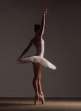 Young beautiful ballerina is posing in studio - 213072866