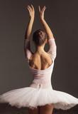 Young beautiful ballerina is posing in studio - 213073431