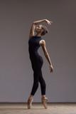 Young beautiful ballerina is posing in studio - 213073604