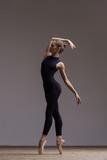 Young beautiful ballerina is posing in studio - 213073649