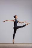 Young beautiful ballerina is posing in studio - 213073894