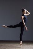 Young beautiful ballerina is posing in studio - 213074008