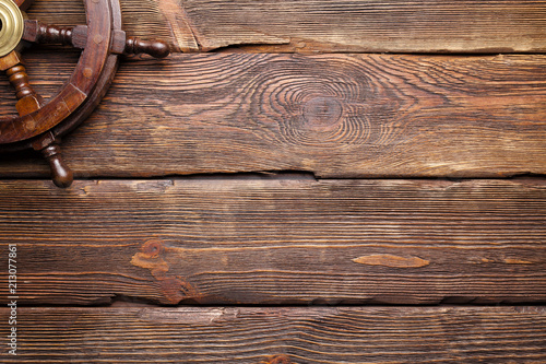 Aluminium Schip Yachting background - ship's steering wheel on wooden board background