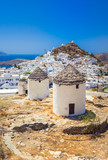 Iconic traditional wind mills in Ios island, Cyclades, Greece. - 213081872