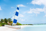 Boat with sail at the beach by the sea. Clear water. - 213086400