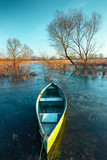 Early spring landscape with wooden boat - 213096217