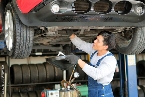 obraz lub plakat Car engine oil repair shop in car garage.