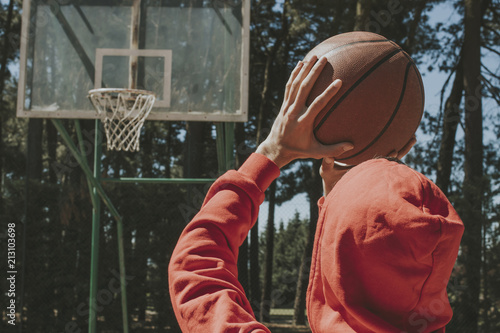 Fotobehang Basketbal young man with basketball ball throwing basket