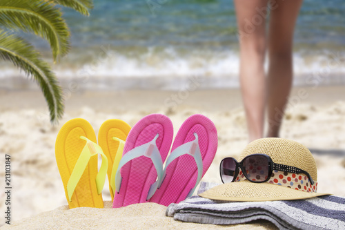 Fotobehang Meloen sandals on the beach, holiday and summer concept