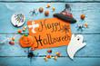 Leinwanddruck Bild - Halloween gingerbread cookies with inscription on orange paper